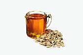 A Pitcher of Honey Next to a Pile of Oats