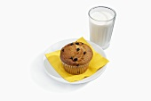 A Blueberry Muffin with a Glass of Milk