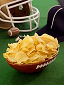 Chips in a Football Bowl with Helmet