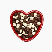 Milk, White and Dark Chocolate Chips in a Heart Shaped Bowl