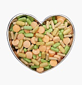 Assorted Pills in a Heart Shaped Bowl
