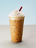 An Iced Mocha Latte with Whipped Cream and a Red Straw