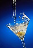 A Martini Pouring into a Glass