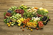 Assorted Fresh Fruits and Vegetables in Containers on Wooden Background