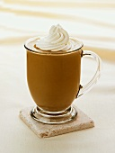 A Mocha Latte with Whipped Cream in a Glass Mug