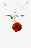 A Red Apple Splashing into Water