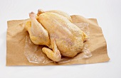 A Whole Uncooked Chicken on Butcher's Paper