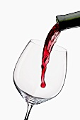 Pouring Red Wine from a Bottle into a Glass
