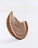 Peanut Butter Cup with Bite Taken Out; White Background