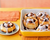 Cinnamon Rolls in a Baking Dish and on a Plate