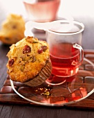 An Orange-Cranberry-Pistachio Muffin with Tea