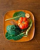 Still life: tomato, seaweed, seeds, beans, mushroom on plate
