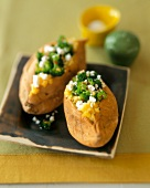 Two Baked Potatoes Stuffed with Feta and Broccoli