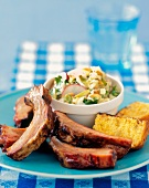 Ribs with Corn Bread and Cole Slaw on a Blue Plate