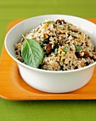 Rice Pilaf with Basil in a White Bowl on a Wooden Tray