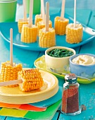 Corn on the Cob on Popsicle Sticks with Spices and Dips