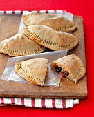 Vegetable Calzones on a Wooden Board