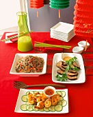 Asian Dishes on a Festive Table (Soba Noodles, Shrimp and Sliced Pork Loin with Coriander)