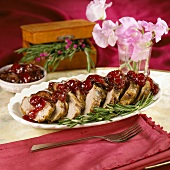 Mustard Marinated Sliced Pork Tenderloin with Cherry Compote on a Platter