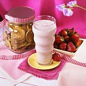 A Strawberry Shake with Cookies and Fresh Strawberries