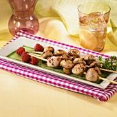 Raspberry Mushroom Kabobs on a Rectangular Platter