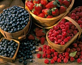 Fresh Blueberries, Strawberries and Raspberries in Baskets