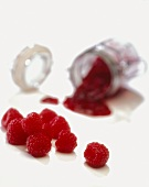 Fresh Raspberries with Raspberry Jam Spilling from a Glass Jar