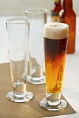 A Black and Tan with Two Empty Glasses