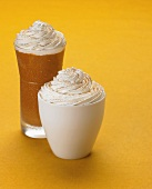 A Pumpkin Shake and a Cup of Ice Cream with Whipped Cream and Cinnamon