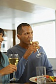 Couple drinking white wine with meal