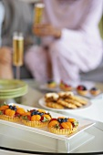 Fruit Tartlets and Other Sweets on a Coffee Table