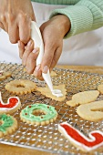 Squeezing Icing onto Holiday Cookies
