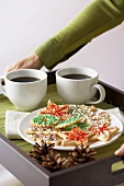A Plate of Christmas Cookies with Two Cups of Coffee on a Tray