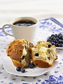 A Blueberry Muffin, Halved, with Butter and Coffee