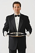 Butler holding a silver tray