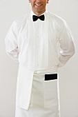 Waiter in white uniform