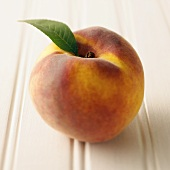 A Whole Peach with a Single Leaf