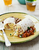 An Egg and Ham Breakfast Burrito with Salsa and  Beans