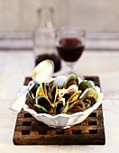 Green Mussels in White Bowl with Spoon and Red Wine