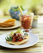 A Taco Salad with a Glass of Salsa