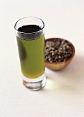 Hemp Oil in a Glass with Seeds