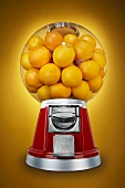 Oranges in a Candy Dispenser