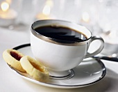 A Cup of Coffee with Two Jelly Filled Cookies