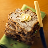 A Stack of Apple Bread Slices with Butter and a Knife