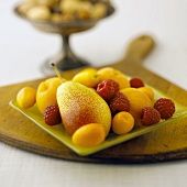 Apricots, Raspberries and a Pear on a Square Glass Plate