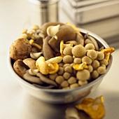 Assorted Fresh Mushrooms in a Metal Bowl