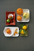 Assorted Citrus Fruits on a Variety of Plates