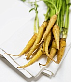 A Bunch of Fresh Carrots on a White Cloth