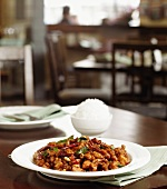 Kung Pao Chicken with White Rice in a Restaurant