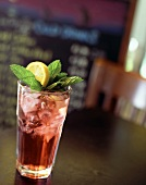A Glass of Raspberry Iced Tea with Mint and Lemon
